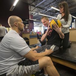 Physical therapists Matt Hansen and Jan Black work with Dustin Shillcox, a paraplegic from Wyoming, Monday, April 21, 2014, at Neuroworx in South Jordan.