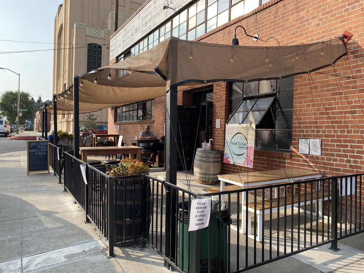 Fenced-off outdoor seating in front of the Original Pattern Brewing Company