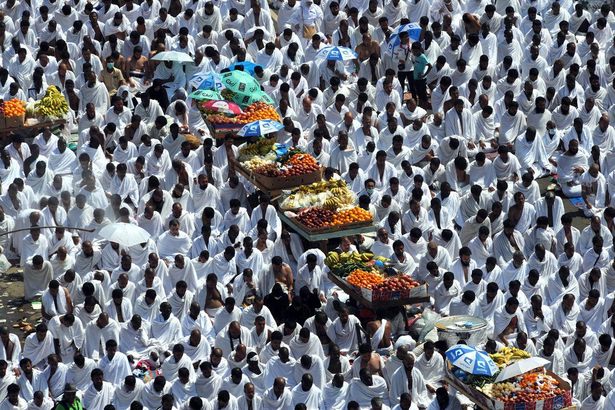 Muslim Hajj pilgrims performing noon prayers at the Namira mosque near Mount Arafat in Saudi Arabia, 2013.