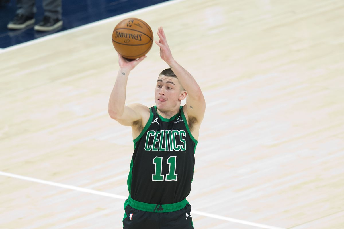 Boston Celtics guard Payton Pritchard shoots the ball during the first half against the Utah Jazz at Vivint Smart Home Arena.