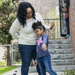 Tiffany Norwood and her daughter Natasha stand in front of their home, Tuesday, April 28, 2020.