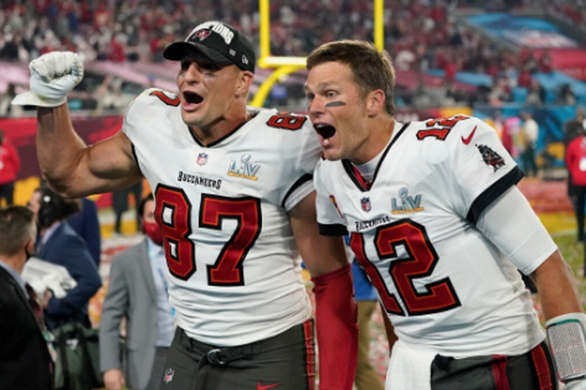Quarterback Tom Brady (right) and tight end Rob Gronkowski celebrate the Bucs' Super Bowl victory Sunday against the Chiefs.