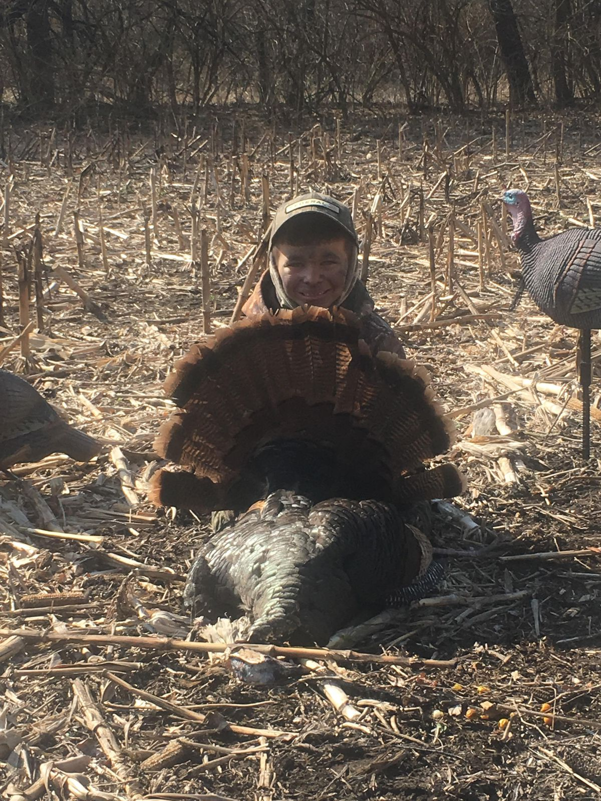 Another view of Tucker Stobaugh in the field with decoys.<br>Provided