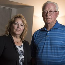 Suzanne Rengers, and her father, Frank Arnold Horton, who say they were both scammed by their tax preparer and financial manager, pose for a photo at Rengers' home in West Jordan on Tuesday, Sept. 27, 2016.