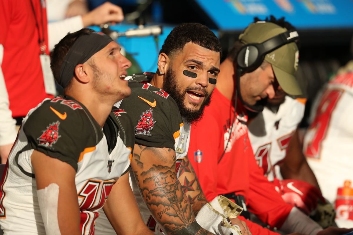 Tampa Bay Buccaneers wide receiver Mike Evans talks with wide receiver Scott Miller in the second half against the Atlanta Falcons at Mercedes-Benz Stadium.