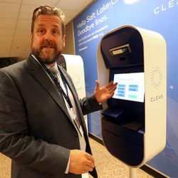 Ricky Gambill, CLEAR Salt Lake City supervisor, talks about his company's new biometric, fee-based service that allows travelers to move past manual ID verification lines using fingerprints and iris scans, at the Salt Lake City International Airport in Salt Lake City on Wednesday, July 12, 2017.