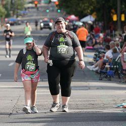 LilliannaEvans (730) and Laura Bradbury (729) compete in the Deseret News Half Marathon in Salt Lake City on Friday, July 23, 2021.