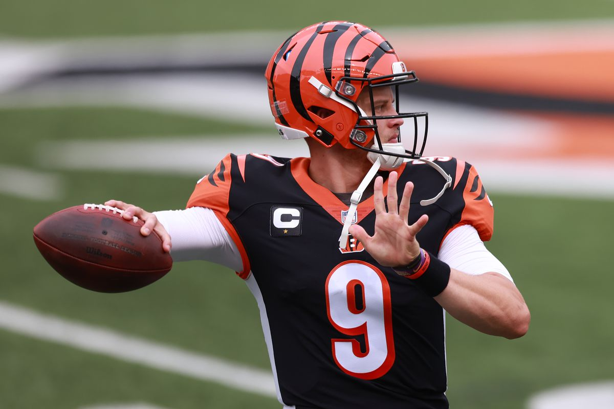 Quarterback Joe Burrow #9 of the Cincinnati Bengals throws a pass as he warms up before playing against the Los Angeles Chargers at Paul Brown Stadium on September 13, 2020 in Cincinnati, Ohio.