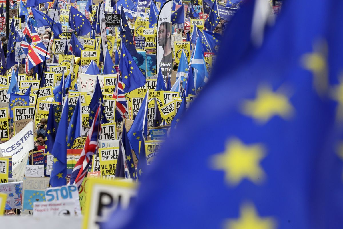 Demonstrators carry posters and flags during a Peoples Vote anti-Brexit march in London, Saturday, March 23, 2019. The march, organized by the People's Vote campaign is calling for a final vote on any proposed Brexit deal. This week the EU has granted Bri