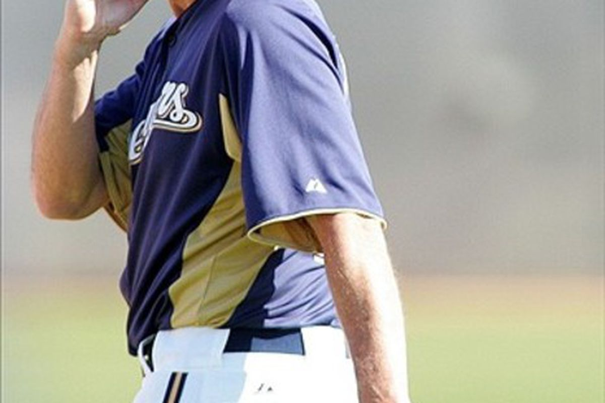 Feb 26, 2012; Phoenix, AZ, USA; Milwaukee Brewers manager Ron Roenicke (10) bites his nails during a workout during spring training at Maryvale Baseball Park.  Mandatory Credit: Jake Roth-US PRESSWIRE