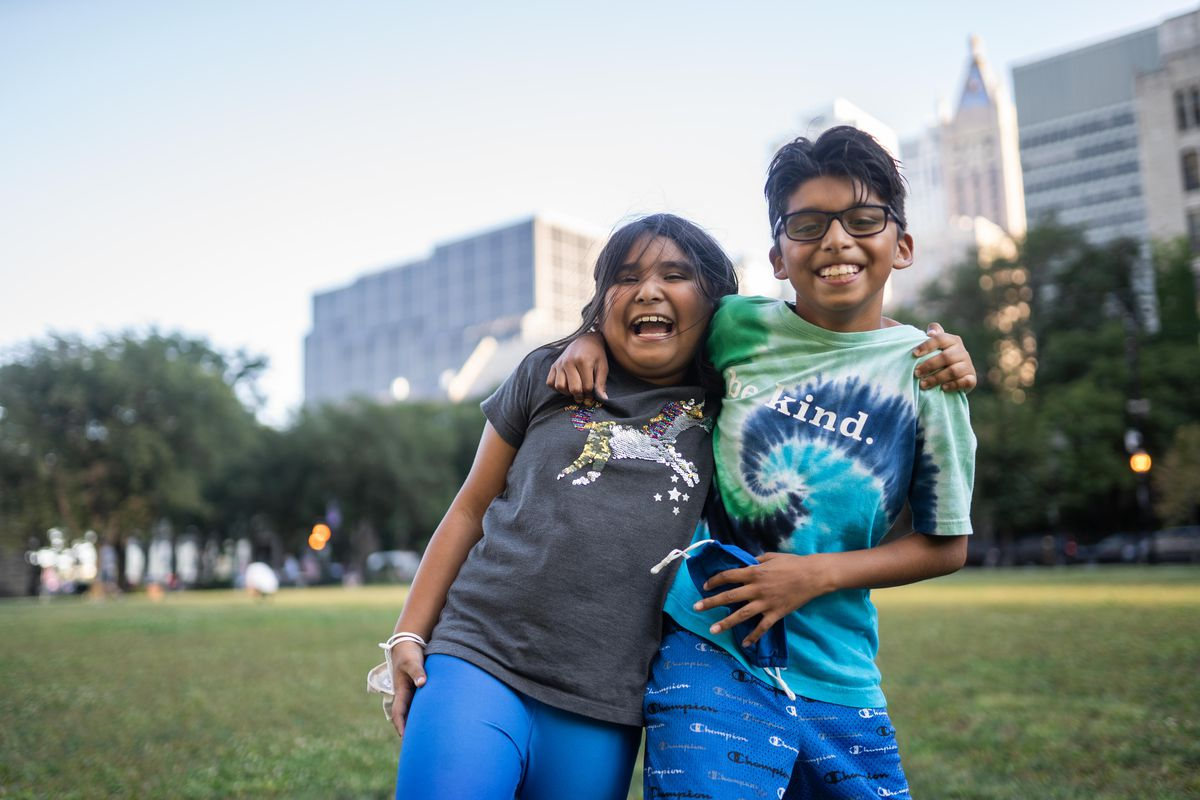Franklin Fine Arts Center students Celeste Hernandez, 8, and her brother Juan Carlos, 10, pose for a picture at Lake Shore Park in the Gold Coast neighborhood, Sept. 15, 2021.