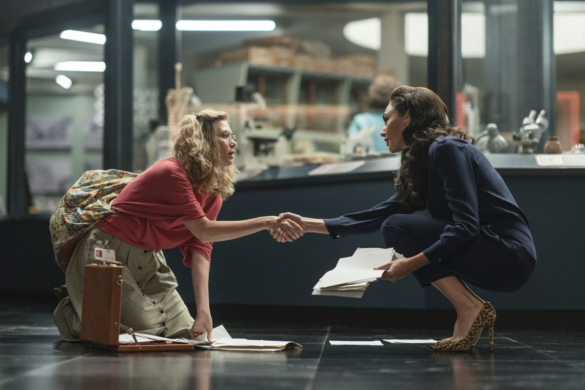 Diana meets Kristin Wiig's Minerva after the bump into each other and drop their papers in Wonder Woman 1984