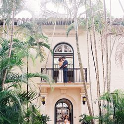 """An engagement shoot at <a href=""""http://villa-woodbine.com/"""">Villa Woodbine</a> packs in the ultimate dose of glamour in a tropical setting. Have your photographer snap candids as you wander upon the foliage, and stage the ultimate Romeo and Juliet pose on"""