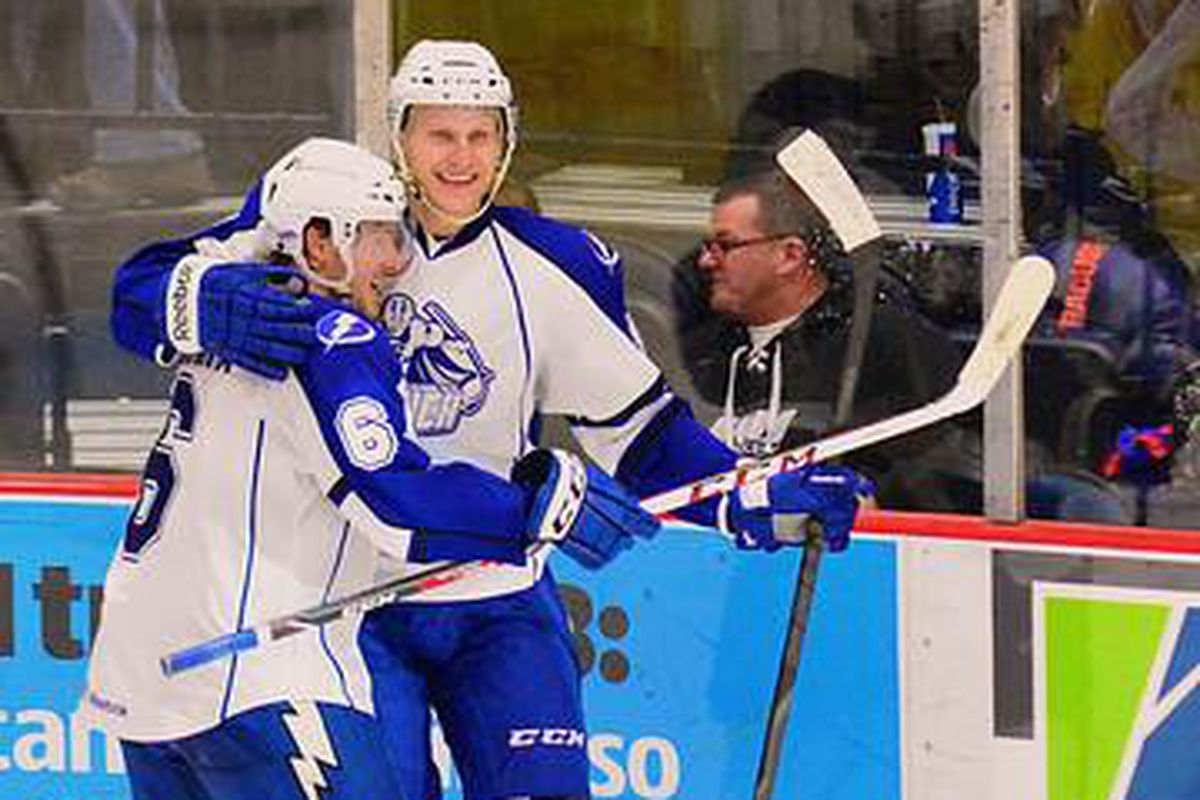 Syracuse Crunch Matt Taormina (6) celebrates Richard Panik (14) overtime goal against the Adirondack Phantoms in American Hockey League (AHL) action at the War Memorial Arena on Saturday, March 1, 2014. Syracuse won in overtime, 5-4.