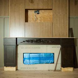 An upstairs fireplace.