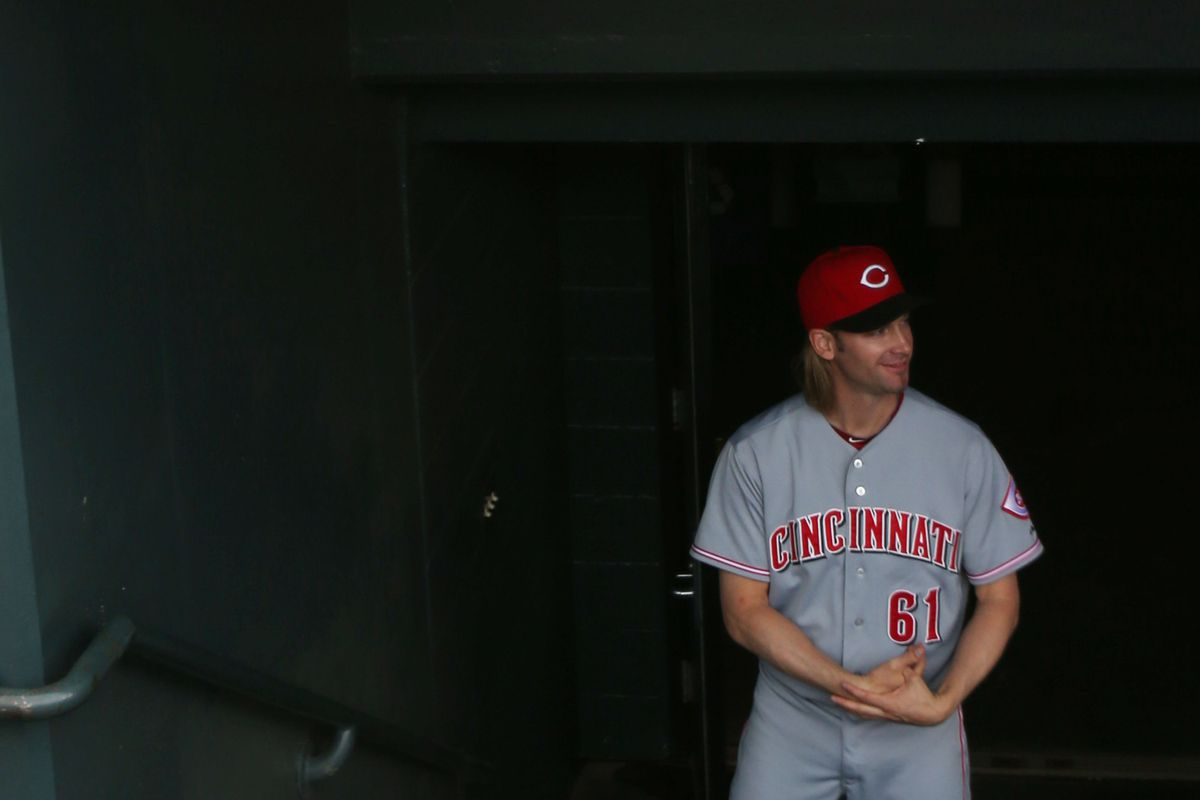 July 27, 2012; Denver, CO, USA; Cincinnati Reds pitcher Bronson Arroyo (61)about to come onto the field before the first inning against the Colorado Rockies at Coors Field. Mandatory Credit: Chris Humphreys-US PRESSWIRE