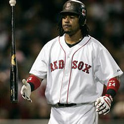 Red Sox batter Manny Ramirez flips his bat after striking out in the third inning against the Toronto Blue Jays Wednesday night at Fenway Park.
