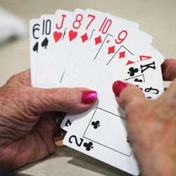 Seniors play cards after eating lunch at Millcreek Senior Center in Salt Lake City Wednesday, May 21, 2014.