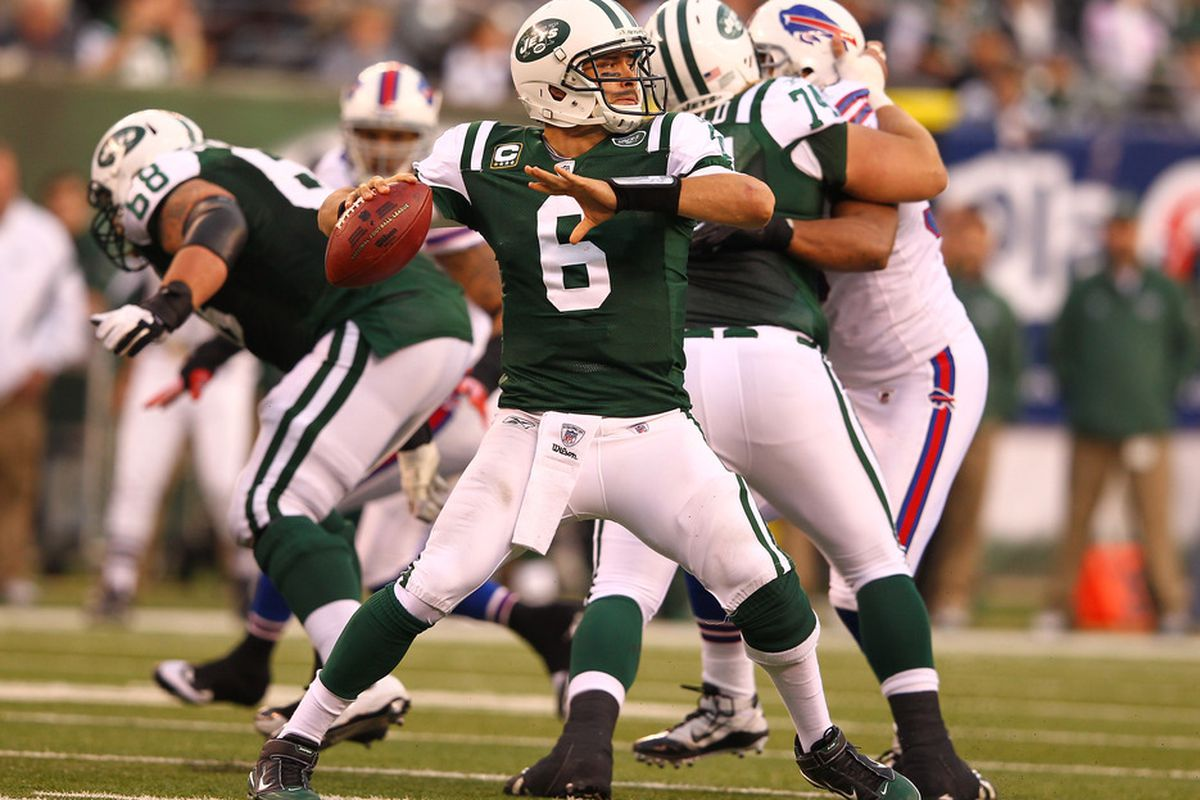 Mark Sanchez of the New York Jets passes against the Buffalo Bills during their game on November 27, 2011 at  MetLife Stadium in East Rutherford, New Jersey.  (Photo by Al Bello/Getty Images)