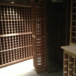 Custom wine storage in the basement allows Eno to squeeze in as many bottles as possible.