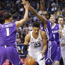 Brigham Young Cougars forward Yoeli Childs (23) is surrounded by Portland Pilots in Provo on Thursday, Dec. 28, 2017.