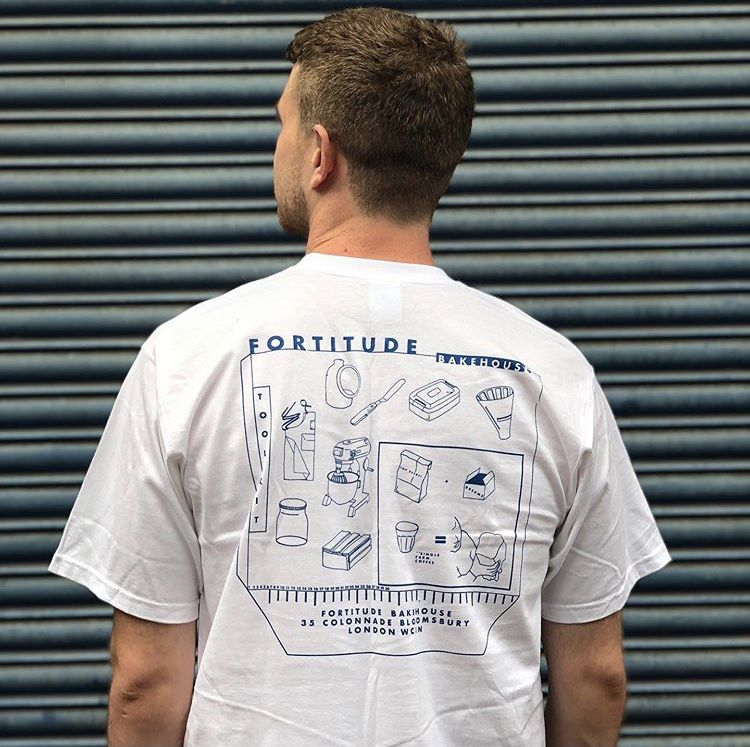 The best London restaurant merch to buy right now includes this white t-shirt with blue illustrations of bread ingredients from Fortitude