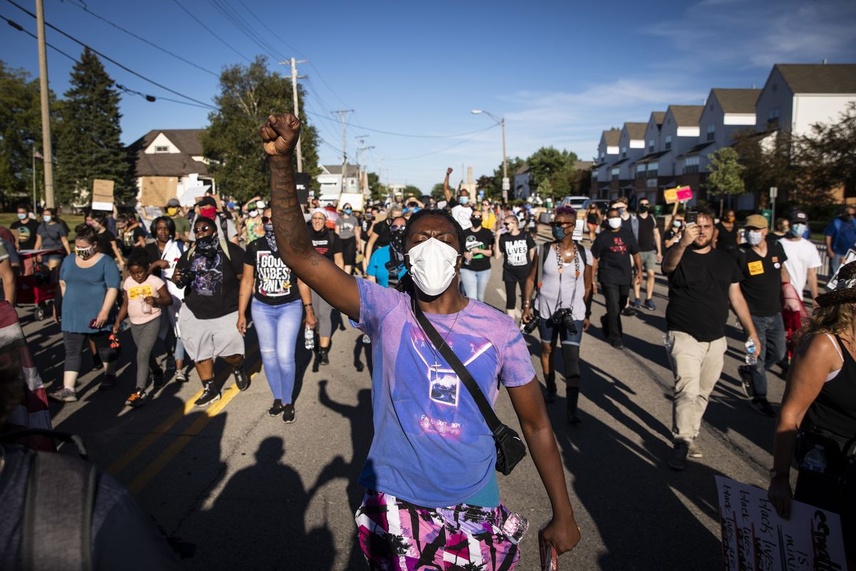 More than a thousand supporters and Black Lives Matter protesters join the family of Jacob Blake to march through the streets of Kenosha, six days after he was shot in the back by a police officer in the Wisconsin city, Saturday, Aug. 29, 2020.