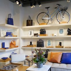 Sleek leather bags and accessories are in the front room.