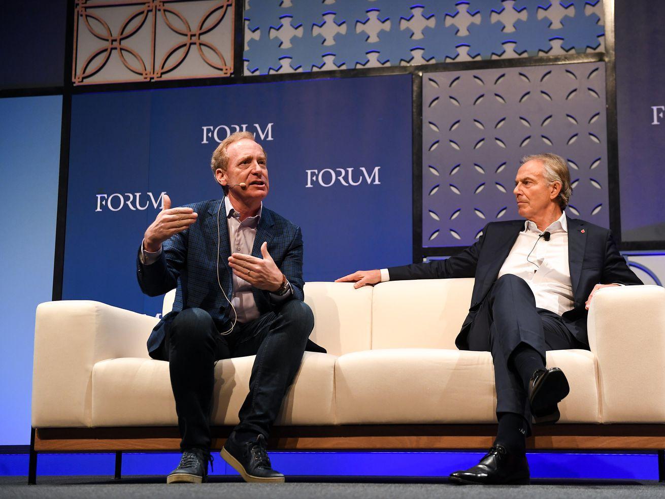 Brad Smith, left, and former British Prime Minister Tony Blair
