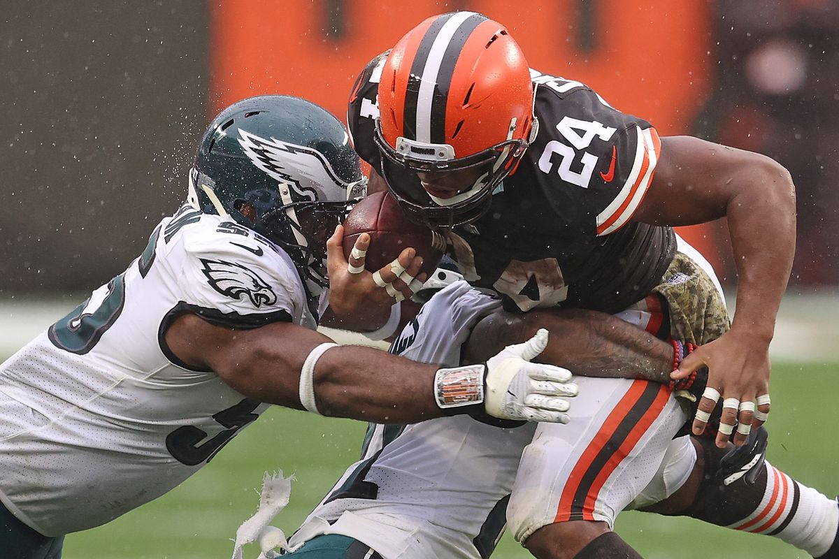 Nick Chubb #24 of the Cleveland Browns is brought down by Jalen Mills #21 of the Philadelphia Eagles during the second half at FirstEnergy Stadium on November 22, 2020 in Cleveland, Ohio.