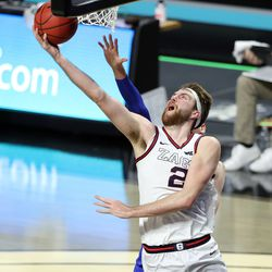Gonzaga Bulldogs forward Drew Timme (2) puts in a shot with Brigham Young Cougars forward Matt Haarms (3) defending as BYU and Gonzaga play in the finals of the West Coast Conference tournament at the Orleans Arena in Las Vegas on Tuesday, March 9, 2021. Gonzaga won 88-78.