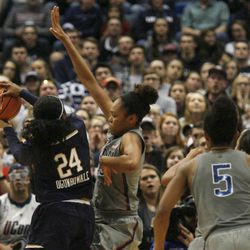 UConn's Azura Stevens (23) tries to prevent Notre Dame's Arike Ogunbowale (24) from making a shot during the Notre Dame Fighting Irish vs UConn Huskies women's college basketball game in the Women's Jimmy V Classic at the XL Center in Hartford, CT on December 3, 2017.