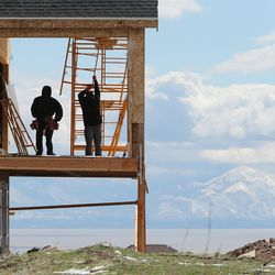 Construction crews work on a residential home in Lehi on Wednesday, March 23, 2016. Salt Lake County's population of 1.1 million is almost double that of Utah County, the state's next most populous county. But Utah County could soon be gaining a larger number of people each year than its neighbor to the north thanks to a thriving tech industry and overall economic opportunity that bring in a steady stream of new residents.