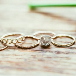 """Half round diamond band (center), <a href=""""http://blancamonrosgomez.com/collections/rings/products/1-2-round-diamond-band-2"""">$880</a>"""