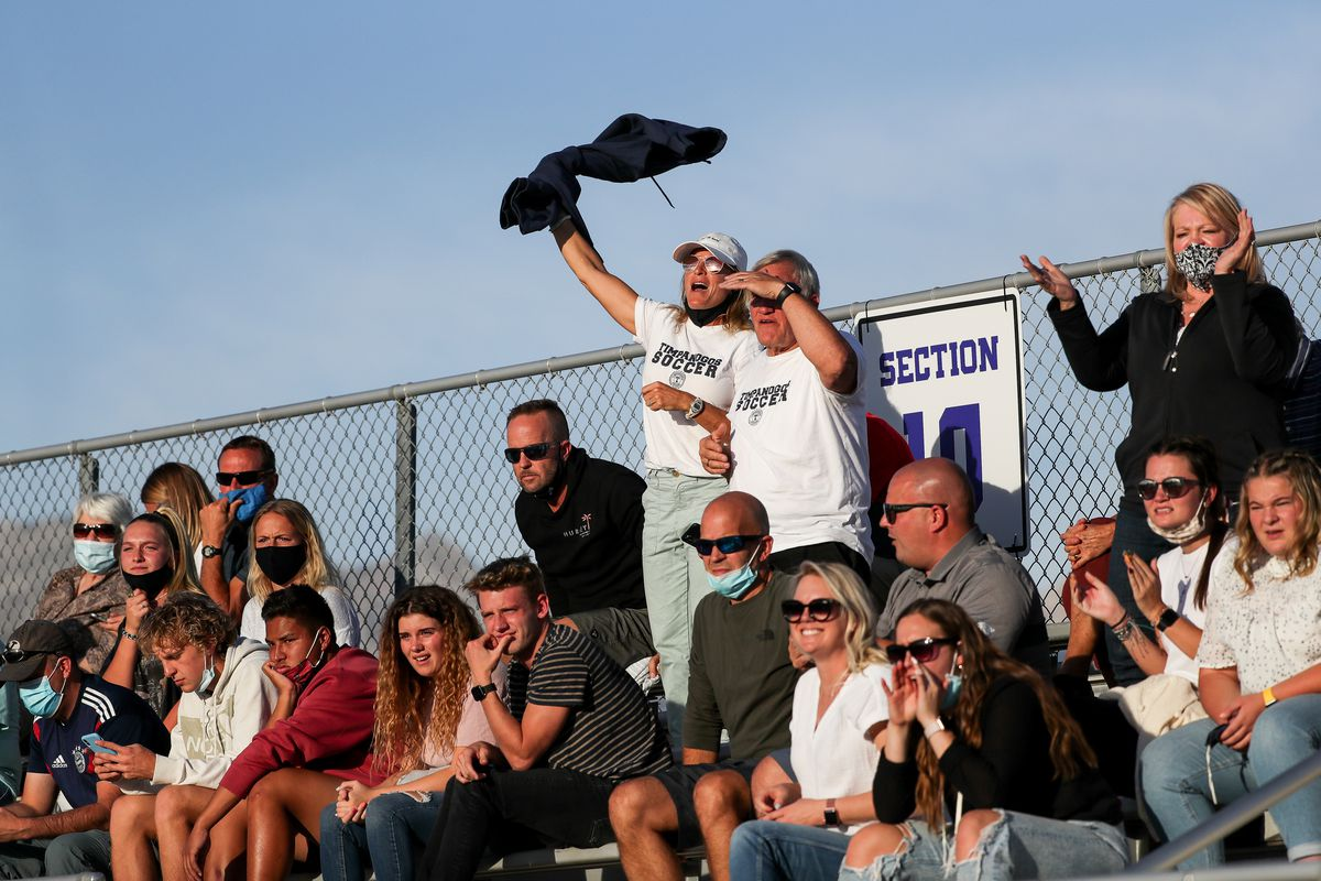 """Timpanogos fans watch a girls soccer game between Lehi and Timpanogos in Lehi on Tuesday, Oct. 13, 2020. Due to a surge in new cases of COVID-19, state officials on Tuesday announced masks will now be required across the state """"anywhere people congregate together for an event."""""""