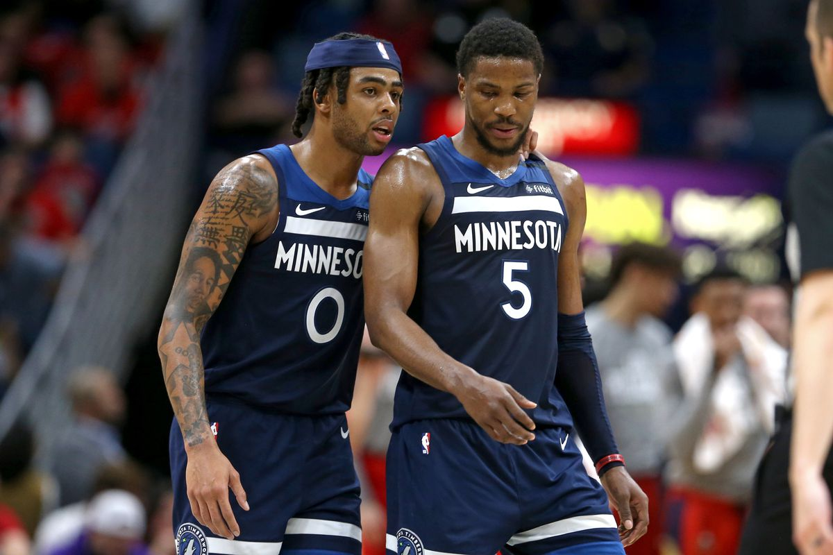 Minnesota Timberwolves guards D'Angelo Russell and Malik Beasley talk in the second half against the New Orleans Pelicans at the Smoothie King Center.