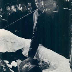 Mourners pass the body of slain Black Panther leader Fred Hampton at Rayner & Sons Funeral Home, 3654 W. Roosevelt.