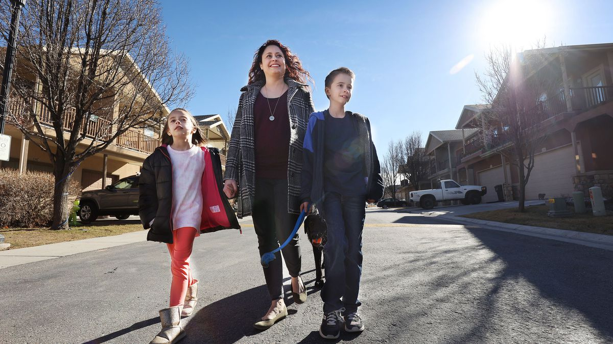 Lisa Sledge, a lawyer and a single mother of two, center, walks with her children Emmett and Bethany and dog Marshall in West Jordan on Sunday, Feb. 7, 2021. Sledge earned a law degree while raising her children on her own and wants to help others through her new nonprofit Freedom for Resilient Women.
