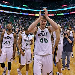 Utah Jazz forward Jack Cooley (45) and plays walk off the court after the Utah Jazz defeats the Dallas Mavericks  109-92 in NBA basketball during their last home game of the season, Monday, April 13, 2015, in Salt Lake City.