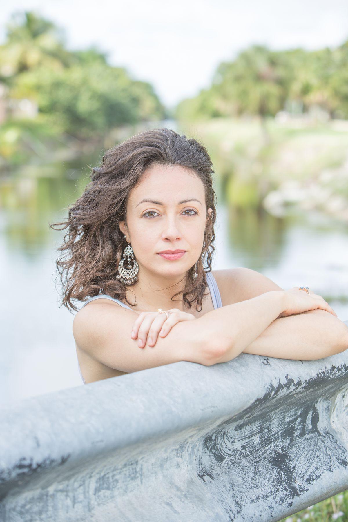 Portrait photograph of author Jennine Capó Crucet showing head and shoulders.