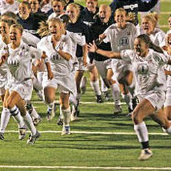 Woods Cross players run in celebration upon defeating Bountiful in a shootout to take the 4A girls soccer championship last month in Draper.