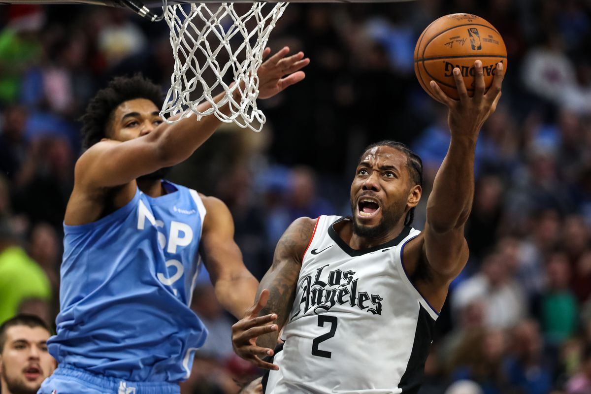Los Angeles Clippers forward Kawhi Leonard shoots over Minnesota Timberwolves center Karl-Anthony Towns during the second quarter at Target Center.