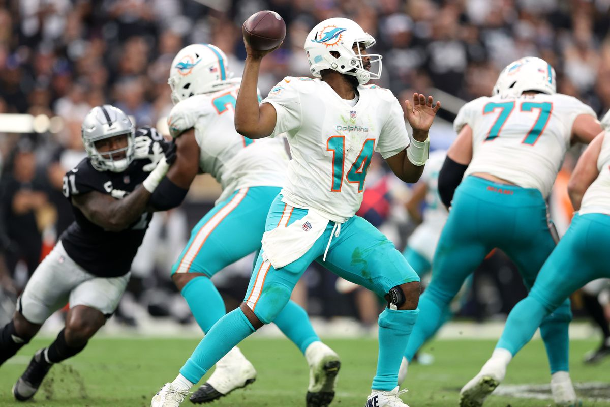 Jacoby Brissett #14 of the Miami Dolphins drops back to pass during the game against the Las Vegas Raiders at Allegiant Stadium on September 26, 2021 in Las Vegas, Nevada.