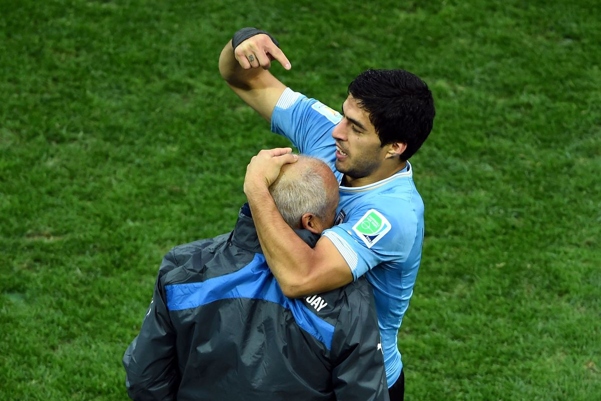 Above: Luis Suarez asking his waiter for some BBQ sauce to dip his coach in.