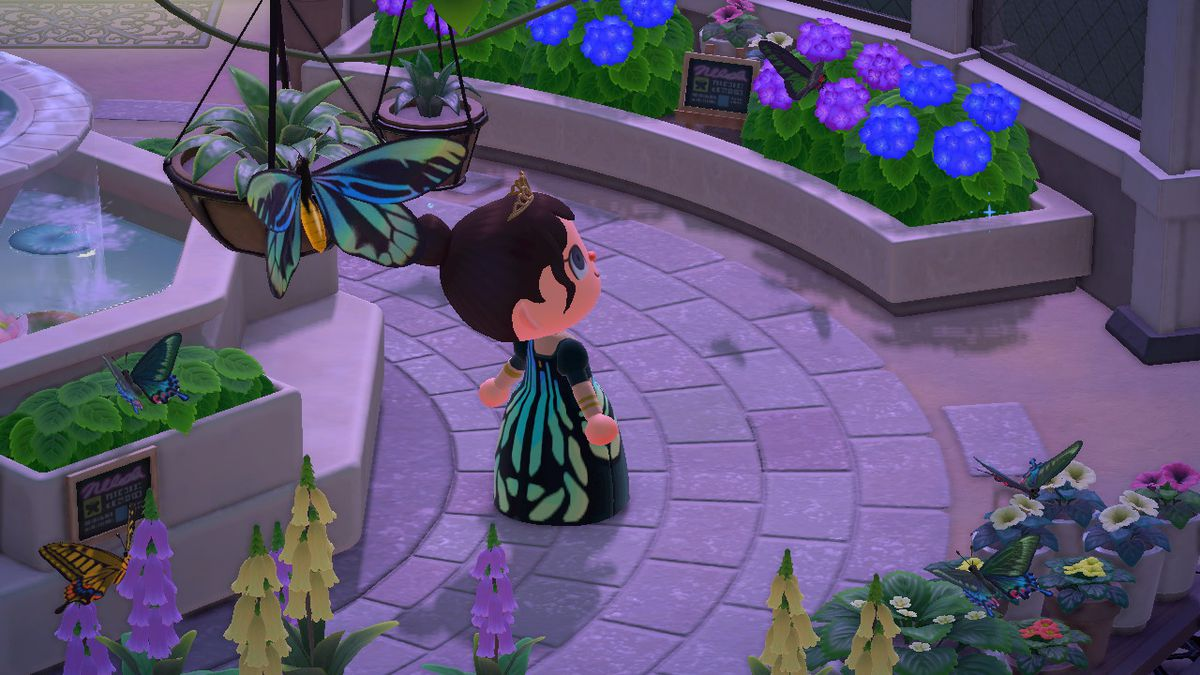 Animal Crossing - a player in a custom butterfly dress stands next to the inspiration in a stone plaza