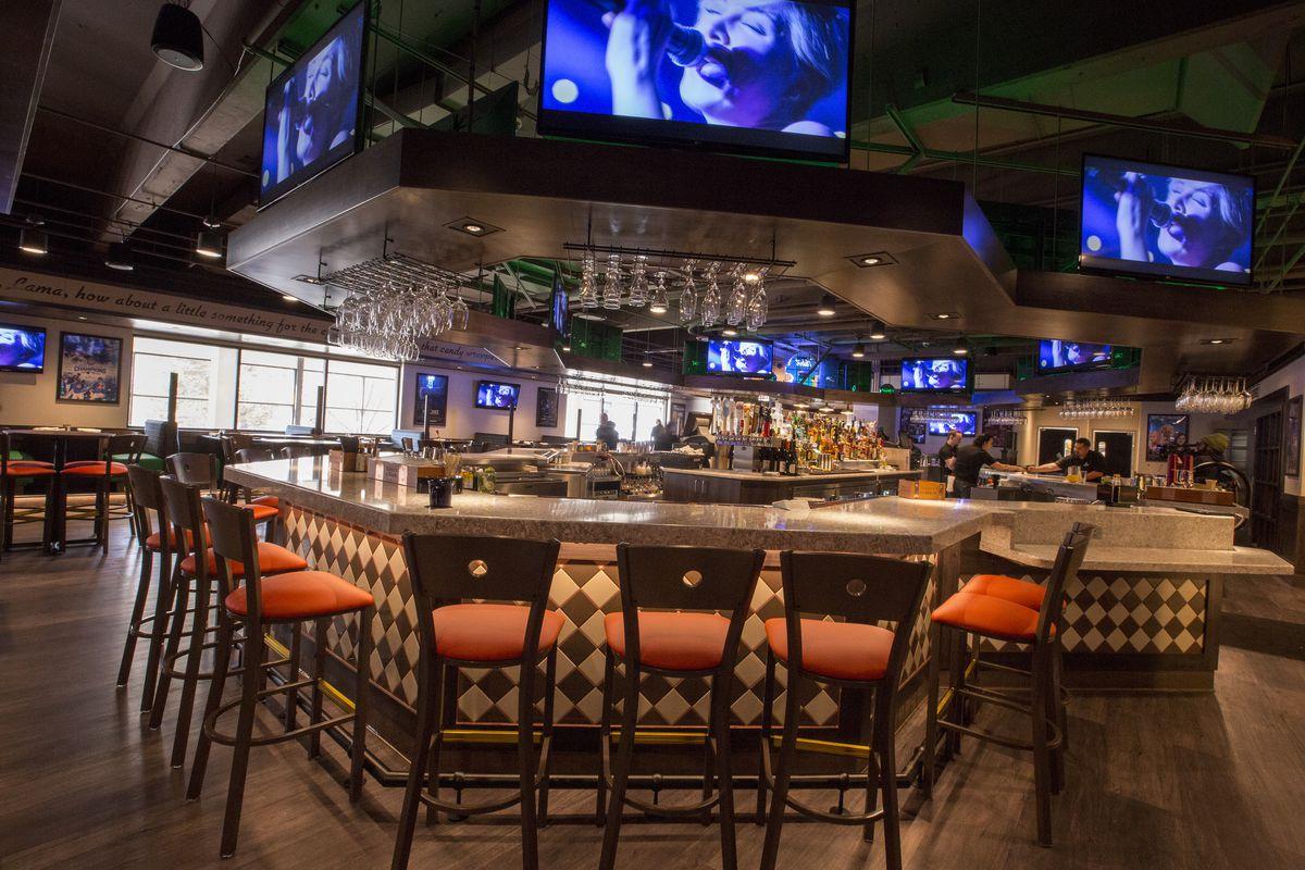 A Mive Bar Serves As The Restaurant S Centerpiece