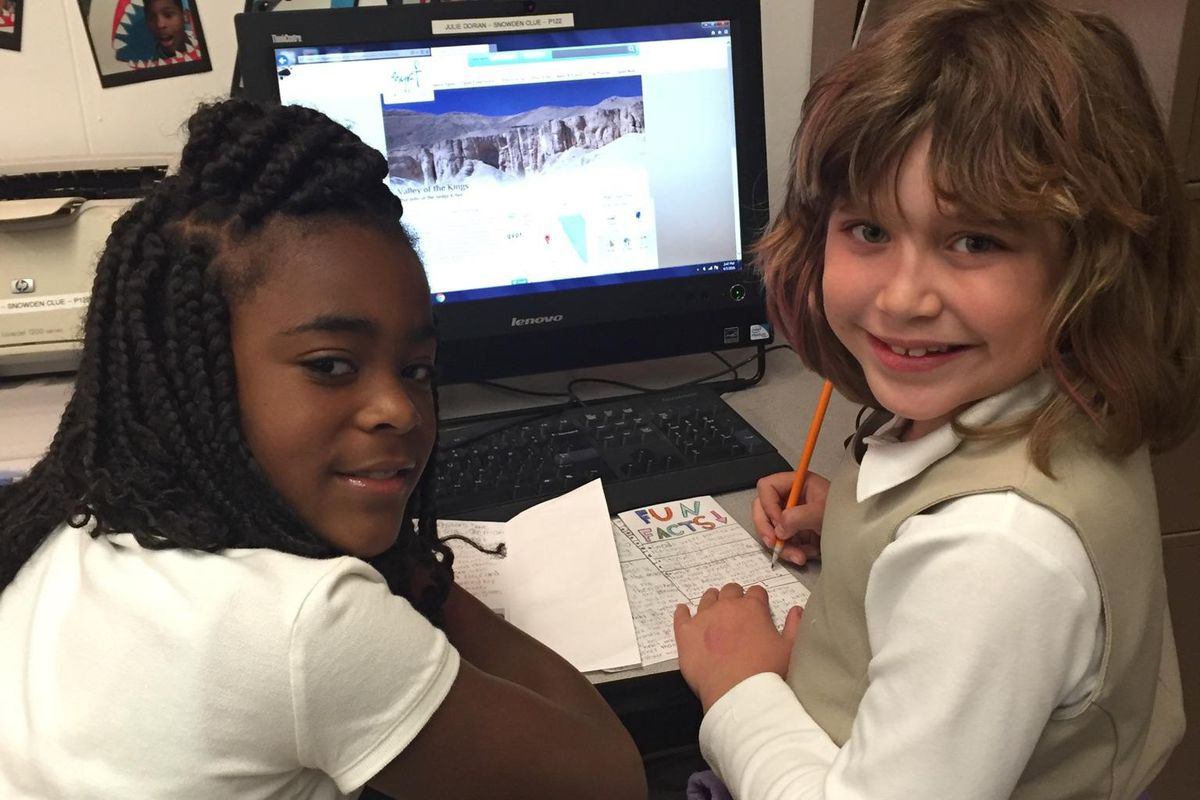 """From left: India Turner and Nina Crespo do online research for an ancient Egypt """"travel guide"""" during a CLUE class for gifted and talented students at Snowden School in Memphis."""