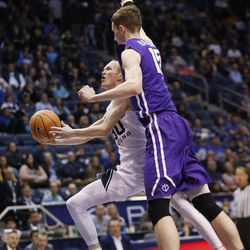 Brigham Young Cougars guard TJ Haws (30) drives on Portland Pilots center Philipp Hartwich (15) in Provo on Thursday, Dec. 28, 2017. BYU won 69-45.
