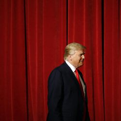 Republican presidential candidate Donald Trump walks onstage for a rally at the Surf Ballroom in Clear Lake, Iowa, on Saturday, Jan. 9, 2016.