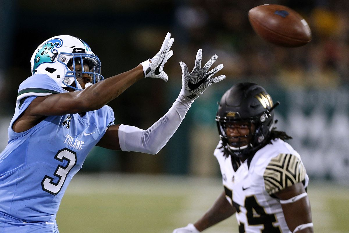 Darnell Mooney #3 of the Tulane Green Wave catches the ball as Ja'Sir Taylor #24 of the Wake Forest Demon Deacons defends during the second half on August 30, 2018 in New Orleans, Louisiana.